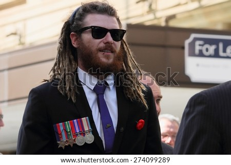 BRISBANE, AUSTRALIA - APRIL 25 : Veteran relative marching in place of during Anzac day centenary commemorations April 25, 2015 in Brisbane, Australia - stock photo