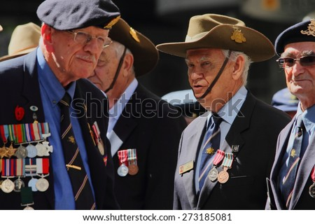BRISBANE, AUSTRALIA - APRIL 25 : Veterans finish march along the route during Anzac day centenary commemorations April 25, 2015 in Brisbane, Australia - stock photo