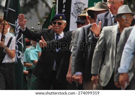 BRISBANE, AUSTRALIA - APRIL 25 : Veterans waving to crowd along the route during Anzac day centenary commemorations April 25, 2015 in Brisbane, Australia - stock photo
