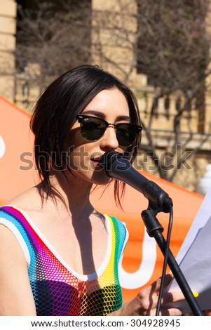 """BRISBANE, AUSTRALIA - AUGUST 8 2015: Jess Origliasso  from """"The Veronicas"""" speaking at Marriage Equality Rally August 8, 2015 in Brisbane, Australia - stock photo"""