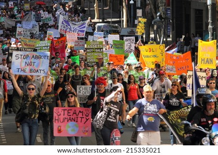 BRISBANE, AUSTRALIA - AUGUST 31: Unidentified protesters street marching with anti LNP government signs at March Australia Rally August 31, 2014 in Brisbane, Australia - stock photo
