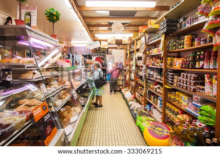 BRISBANE, AUSTRALIA,  CIRCA JUNE 2012: customers shopping in a local deli in Brisbane. More customers are turning away from major supermarkets in favour of stores that have a strong focus on local foods. - stock photo