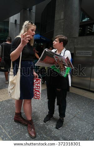 BRISBANE, AUSTRALIA - FEBRUARY 05 : Anti right wing newspaper seller at protest in support of churches offering sanctuary to refugees