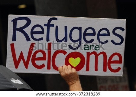 BRISBANE, AUSTRALIA - FEBRUARY 05 : Protest sign in support of churches offering sanctuary to refugees February 05, 2016 in Brisbane, Australia - stock photo