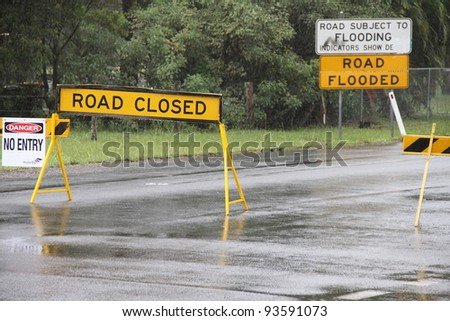 BRISBANE, AUSTRALIA - JAN 25 : One year on Brisbane flooding again, old bay road closed Burpengay January 25, 2012 in Brisbane, Australia - stock photo