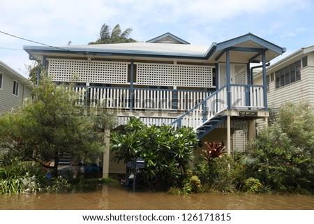 BRISBANE, AUSTRALIA - JANUARY 28 : Houses flooded from ex tropical cyclone Oswald on January 28, 2013 in Brisbane, Australia - stock photo