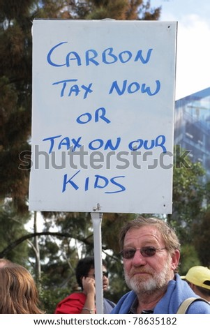 BRISBANE, AUSTRALIA - JUNE 6 : man with pro carbon tax sign during World Environment Day say yes protest 6, 2011 in Brisbane, Australia - stock photo