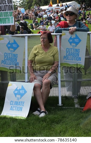 BRISBANE, AUSTRALIA - JUNE 6 : older women with cut pollution and say yes to carbon tax protest signs at during World Environment Day rally 6, 2011 in Brisbane, Australia - stock photo