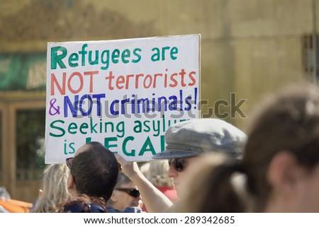 BRISBANE, AUSTRALIA - JUNE 20: Rally goer holding anti- immigration policy at World Refugee Day Rally June 20, 2015 in Brisbane, Australia - stock photo
