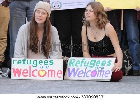 BRISBANE, AUSTRALIA - JUNE 20 : Unidentified protesters take part in World Refugee Day Rally June 20, 2015 in Brisbane, Australia - stock photo