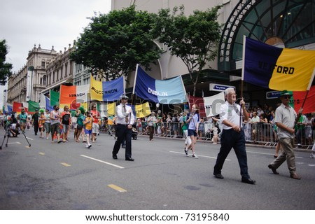 BRISBANE, AUSTRALIA - MAR 12: Parade participants march with various flags to celebrate St Patrick's day on Mar 12, 2011 at the Elizabeth st, Brisbane, Australia.