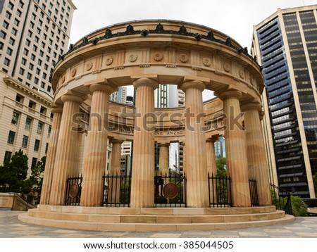 BRISBANE, AUSTRALIA - MARCH 1 2016 - Anzac War Memorial on the heritage-listed town square called Ancaz Square with no people and office buildings of the Brisbane CBD - stock photo