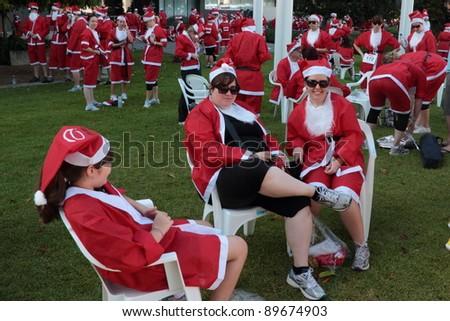 BRISBANE, AUSTRALIA  NOV 27 :Group of unidentified women relax pre Variety Santa Fun Run November 27, 2011 in Brisbane, Australia - stock photo