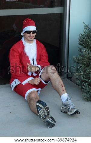 BRISBANE, AUSTRALIA  NOV 27 :Unidentified Santa with leg injury pre Variety Santa Fun Run November 27, 2011 in Brisbane, Australia - stock photo