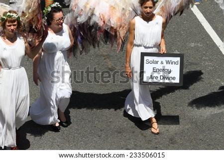 """BRISBANE, AUSTRALIA - NOVEMBER 15: """"Climate Angels"""" protest group at g20 protest on November 15, 2014 in Brisbane, Australia - stock photo"""