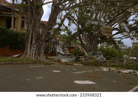 BRISBANE, AUSTRALIA - NOVEMBER 28 : Roof littering tree from super cell hail storm area declared disaster on November 28, 2014 in Brisbane, Australia - stock photo