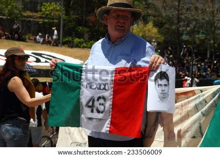 BRISBANE, AUSTRALIA - NOVEMBER 15: Undientified people protesting missing student teachers in mexico at g20 rally on November 15, 2014 in Brisbane, Australia - stock photo