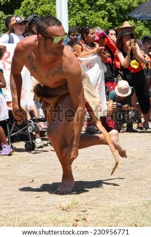 BRISBANE, AUSTRALIA - NOVEMBER 14: Unidentified aboriginal tribal kangaroo dancer at deaths in custody g20 protest on November 14, 2014 in Brisbane, Australia - stock photo