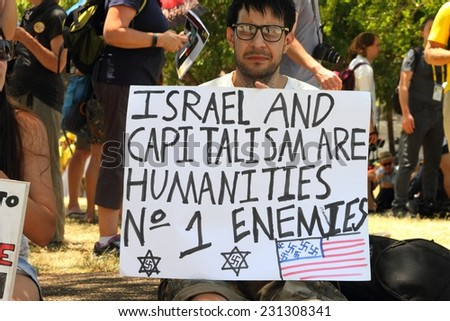 BRISBANE, AUSTRALIA - NOVEMBER 15: Unidentified protestor with anti Israel and capitalism g20 protest sign on November 15, 2014 in Brisbane, Australia - stock photo