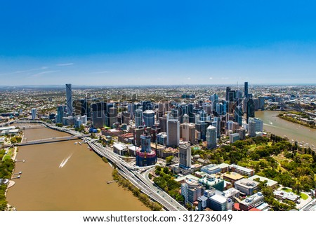 BRISBANE, AUSTRALIA - NOVEMBER 11 2014: View of Brisbane from air over the river. Brisbane is the capital of QLD and the third largest city in Australia. November 11, 2014 Brisbane, Australia - stock photo