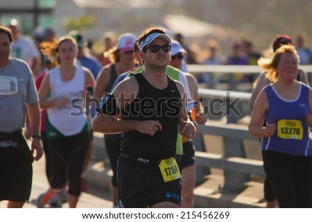 "BRISBANE, AUSTRALIA - SEPTEMBER 07 : Unidentified runners  participating in the ""Bridge to Brisbane"" charity fun run on September 07, 2014 in Brisbane, Australia - stock photo"
