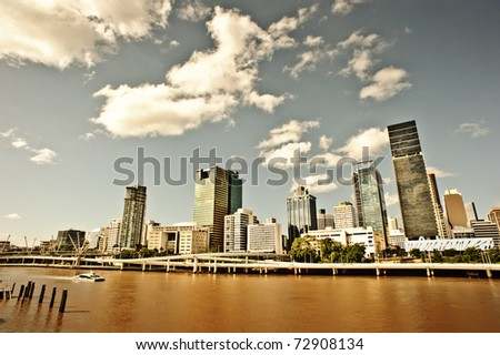 Brisbane city is along with Brisbane river which is colored yellow and red due to the recent flood. - stock photo