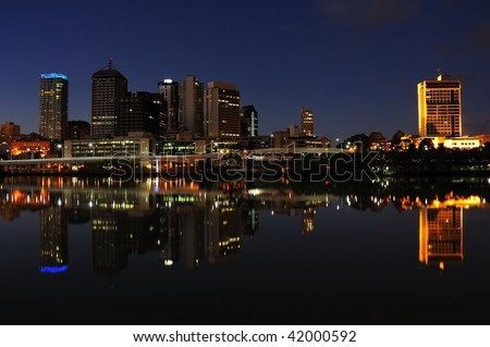 Brisbane city skyline at night with the river