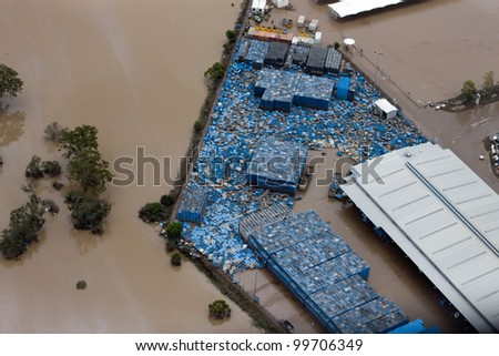 Brisbane Flood 2011 Aerial View Business Loss. Pallets scattered by flood water during the Brisbane Flood of 2011.  One of hundreds of businesses suffering loss after Brisbane River broke its banks.