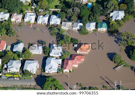 Brisbane Flood JANUARY 2011 Aerial View of homes under water in Australia's worst flooding disaster. Also features paddlers surveying damage.