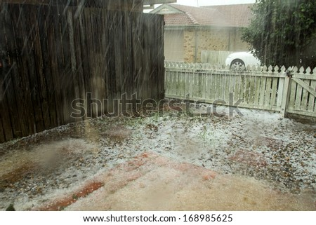 BRISBANE - NOVEMBER 18: Storms dump hail the size of golf-balls on November 18, 2013 in Brisbane, Queensland, Australia. Authorities say the damage bill will run into the millions of dollars. - stock photo