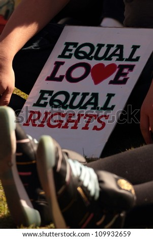 BRISBANE, QLD AUSTRALIA - AUGUST 11 : equal love sign amongst crowd on August 11 2012  in Brisbane, Australia  Equal Love is a gay rights group supporting gay marriage - stock photo