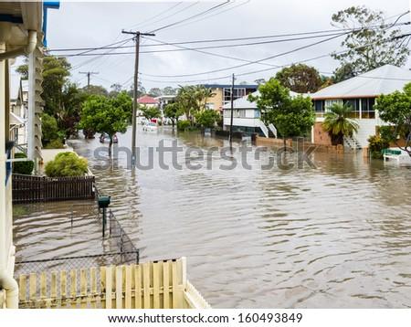 BRISBANE, QLD, AUSTRALIA - January 27: Flood water covers a Brisbane road on 27 January 2013 in Brisbane - stock photo