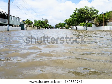BRISBANE, QLD, AUSTRALIA - January 27: View of the flood water up a Brisbane street during the floods in Sandgate on 27 January 2013 in Brisbane  - stock photo