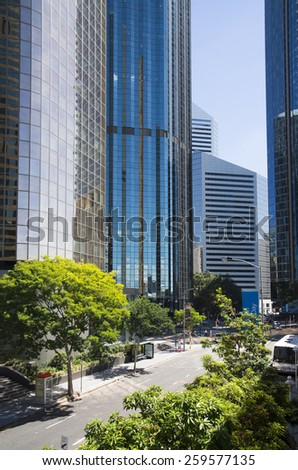 BRISBANE, QLD, AUSTRALIA - MARCH 17, 2014: downtown sstreet view with high rise building skyscraper commercial modern city on riverside in Brisbane, QLD, Australia on March 17, 2014 - stock photo