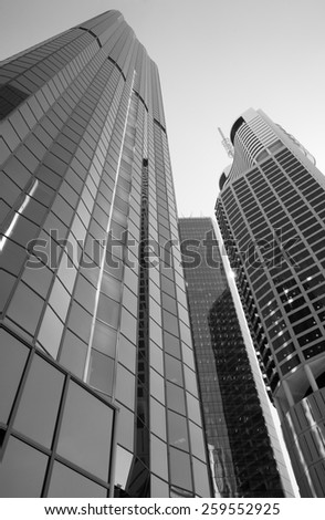BRISBANE, QLD, AUSTRALIA - MARCH 17, 2014: perspective view to steel and glass building skyscraper commercial modern city on riverside in Brisbane, QLD, Australia on March 17, 2014. Black and white - stock photo