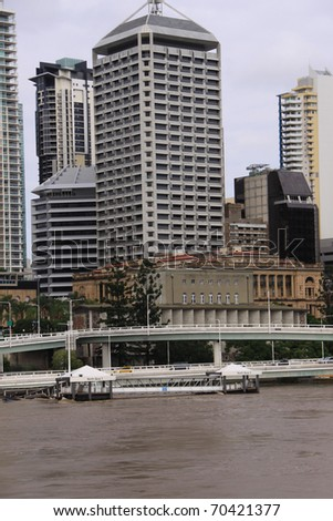 "BRISBANE, QUEENSLAND/AUSTRALIA - JANUARY 13:Destroyed City Cat pontoon ""North Quay""  with down town background on January 13, 2011 in Toowong, Brisbane, Queensland, Australia. - stock photo"