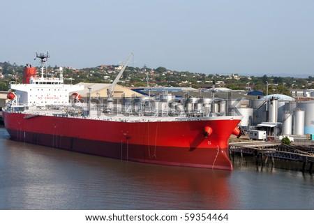 Brisbane: tanker in port. Oil tanker in the proccess of unloading - stock photo