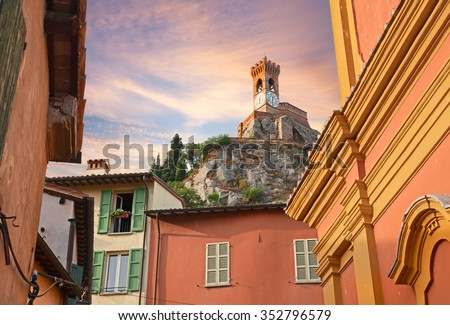 Brisighella, Ravenna, Emilia Romagna, Italy: view of the old clock tower behind houses and church in the medieval town on the hills
