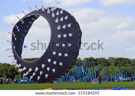 BRISTOL - AUGUST 31: A large spin bowl kite flying at the Bristol International Kite Festival, England, August 31, 2013  - stock photo