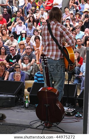 BRISTOL, ENGLAND - AUGUST 2: Guitarist at the annual Harbour Festival in Bristol, England on August 2, 2009. 250,000 people attended the event, the largest of its kind in Europe, over three days. - stock photo