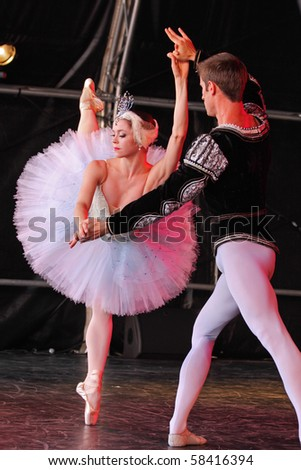 BRISTOL, ENGLAND - AUGUST 1: Megan Fairchild and Andrew Veyette of the New York City Ballet perform Swan Lake in the Dance Village at the  Harbour Festival on August 1, 2010 in Bristol, England. - stock photo