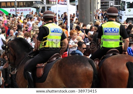 BRISTOL, ENGLAND - AUGUST 2: Mounted police patrol the annual Harbour Festival in Bristol, England on August 2, 2009. An estimated 250,000  attended this free event, the largest of its kind in Europe - stock photo