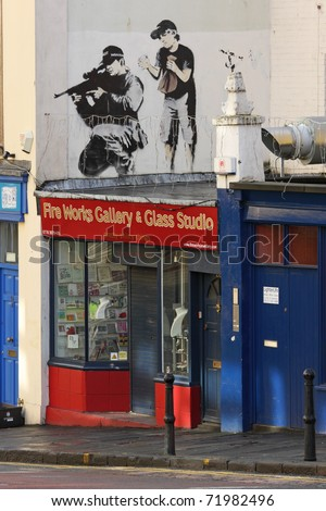 BRISTOL, ENGLAND - FEBRUARY 26: Graffiti by Banksy in Maudlin Street in  Bristol, England on February 26, 2011. Banksy is a native of the city, in which there are many examples of his street art - stock photo