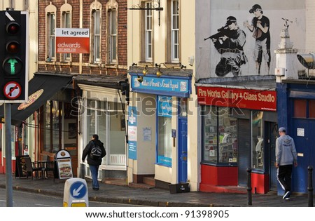 BRISTOL, ENGLAND - FEBRUARY 26: Police sniper by Banksy in Upper Maudlin Street in Bristol, England on February 26, 2011. The image has since been overpainted, allegedly by a rival artist - stock photo