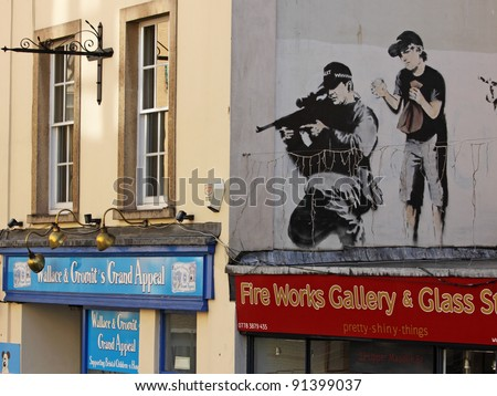 BRISTOL, ENGLAND - FEBRUARY 26: Police sniper by Banksy in Upper Maudlin Street in Bristol, England on February 26, 2011. The image has since been over-painted, allegedly by a rival artist - stock photo