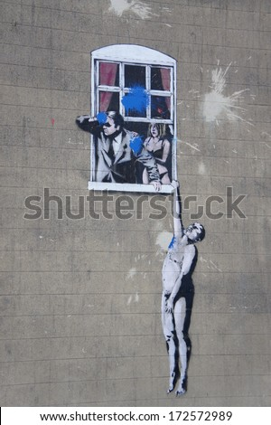 "BRISTOL, ENGLAND - 27 January 2011 : The famous Banksy graffiti  ""Naked Man"" by street artist Banksy at Park Street, Bristol. The contemporary art contains The hanging nude man, husband and wife   - stock photo"