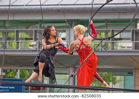 BRISTOL, ENGLAND - JULY 31: Aerial performance in the Dance Village at the Harbour Festival in Bristol, England on July 31, 2011. The free three day event attracted a record 280,000 spectators - stock photo