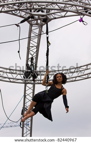 BRISTOL, ENGLAND - JULY 30: Aerial performer at the Harbour Festival in Bristol, England on July 30, 2011. Founded in 1972, this free three day event played host to a record 280,000 spectators - stock photo