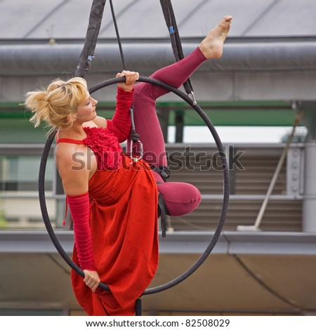 BRISTOL, ENGLAND - JULY 31: Aerial performer in the Dance Village at the Harbour Festival in Bristol, England on July 31, 2011. The free three day event attracted a record 280,000 spectators - stock photo