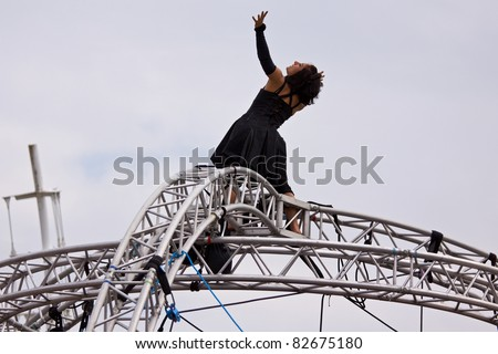 BRISTOL, ENGLAND - JULY 31: An artiste gives an aerial performance in the Dance Village at the Harbour Festival in Bristol, England on July 31, 2011. The three day event attracted 280,000 spectators - stock photo